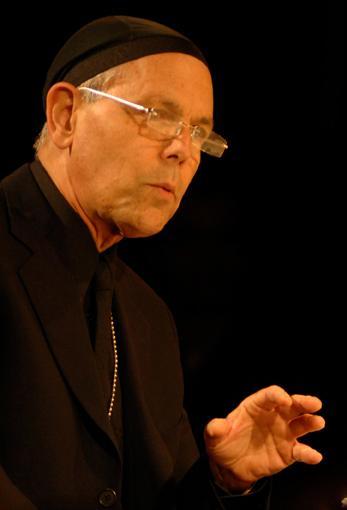 Joe Spano as Father Aquinas