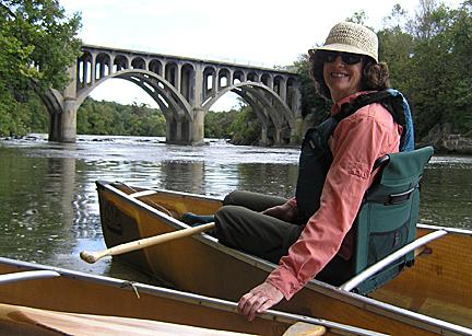 Woman in canoe near bridge at Stockport Flats.